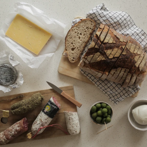 fresh bread with salami, olives and cheeses for virtual party