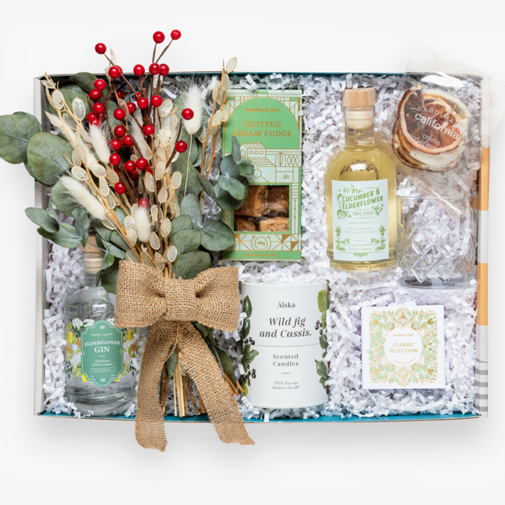 Christmas gift box with gin and fudge and scented candle