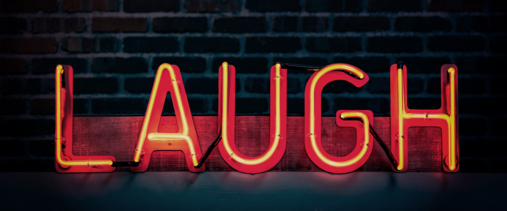 Neon text saying laugh
