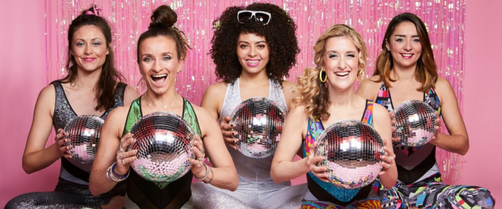 Five woman holding disco glitter balls