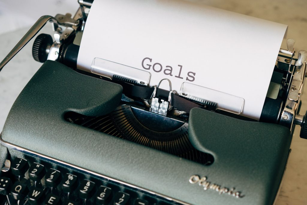 """Type writer with paper printed """"goals"""""""