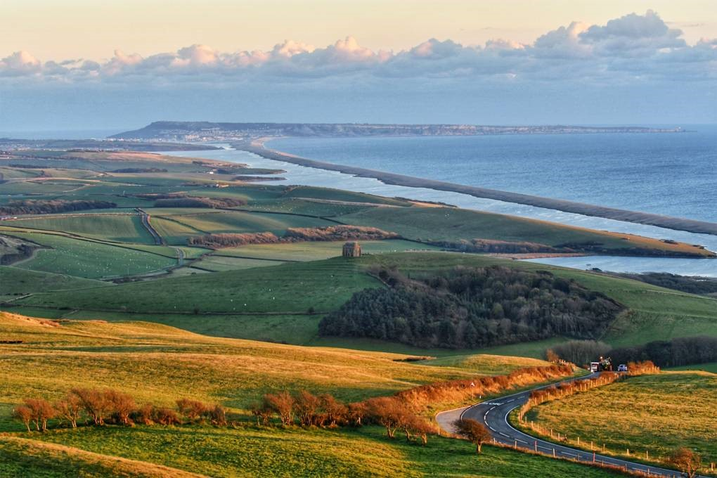 Grass hills and landscape view of the coastline in Dorset